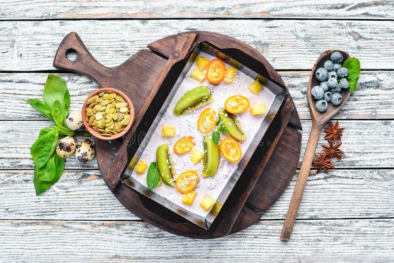 Yogurt with fruit, kumquat, kiwi fruit and apple. Healthy food, restaurant dish delivery. Top view. stock photo
