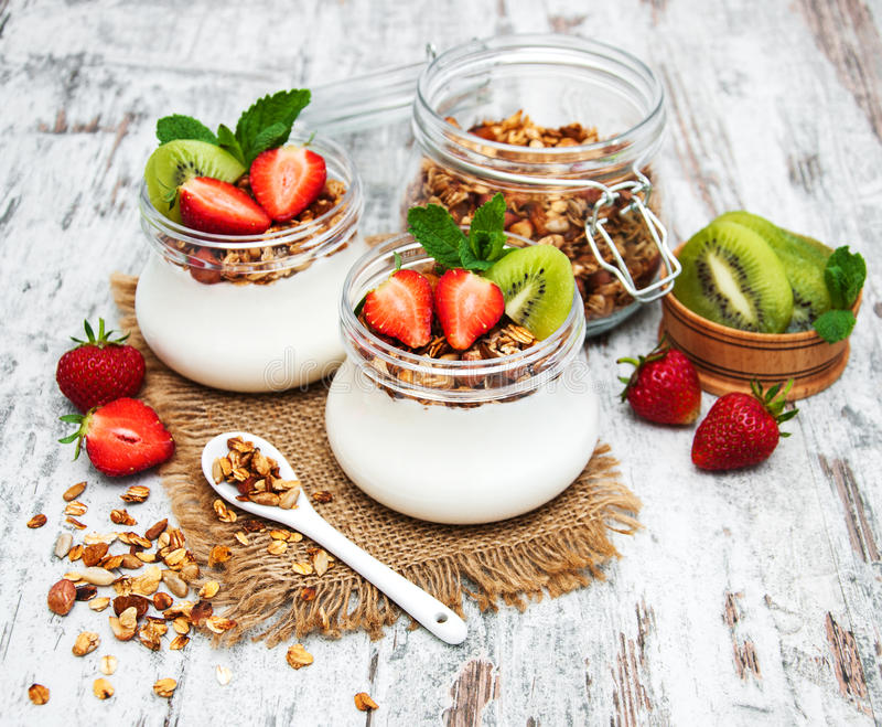 Yogurt and granola for breakfast royalty free stock photo
