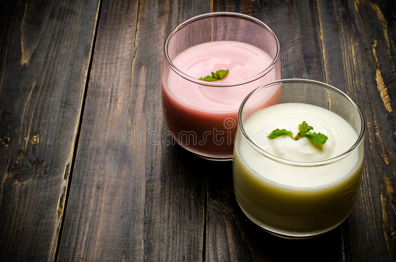 Yogurt. Homemade yogurt in the glass on wooden background,healthy food stock image