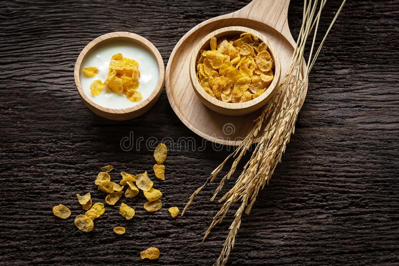 Yogurt with muesli for breakfast in the morning, loss weight and diet slimming for women, old wood background. stock photos
