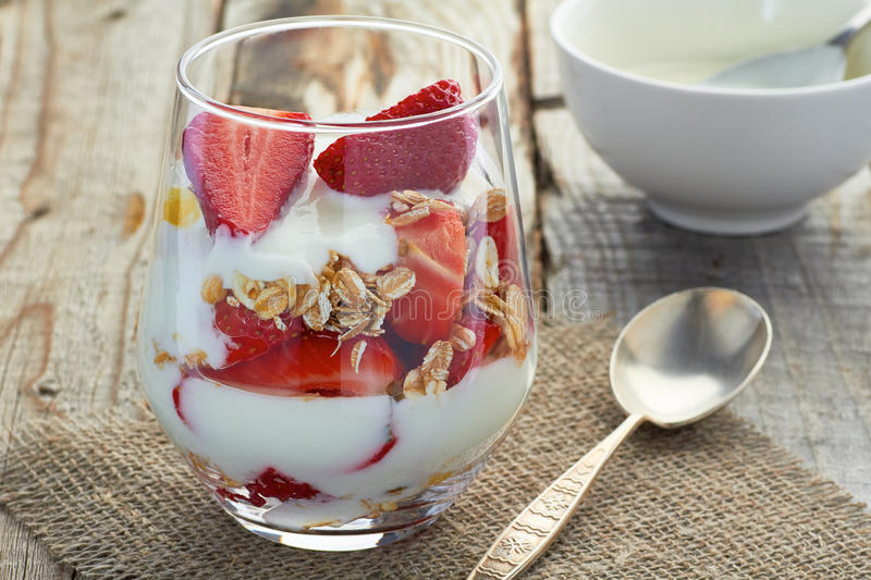 Yogurt with muesli and strawberries royalty free stock images