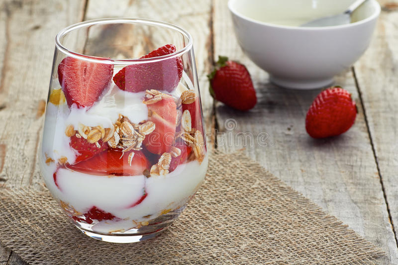 Yogurt with muesli and strawberries royalty free stock photography