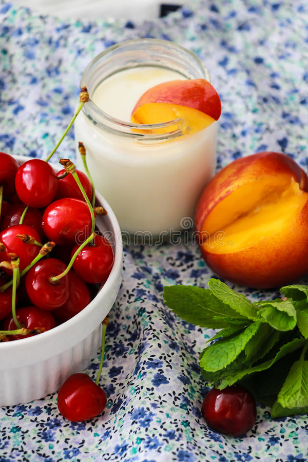 Yogurt with peaches, cherries and mint royalty free stock photo
