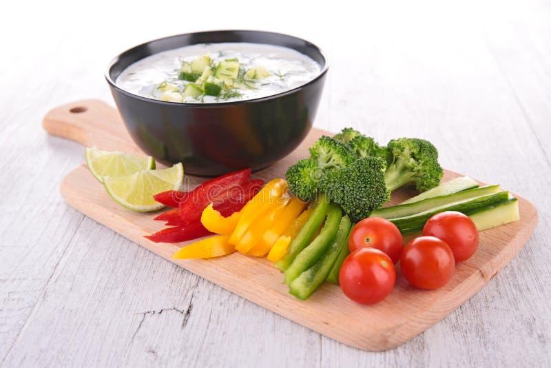 Yogurt sauce and vegetables stock photos