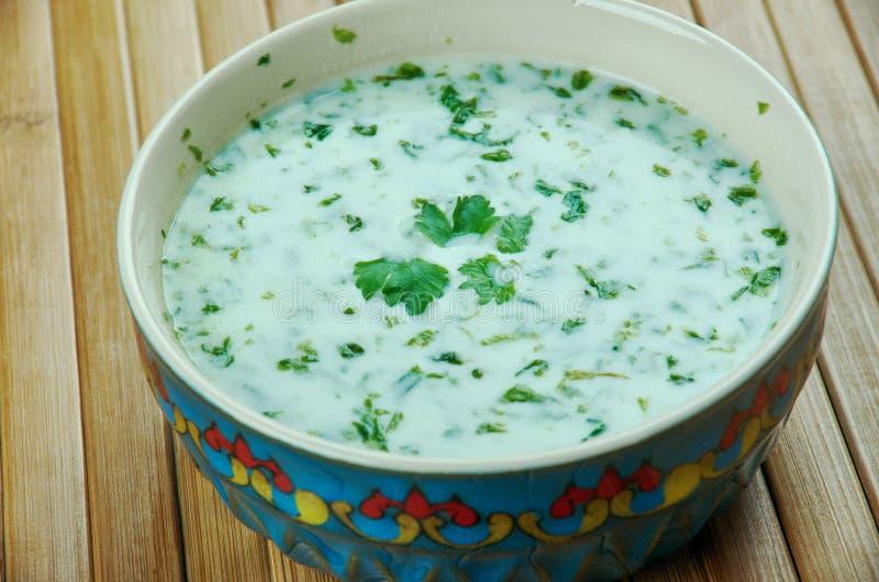 Yogurt soup. Ash-e doogh - yogurt soup from the Azeri-region of Northwest Iran stock photo