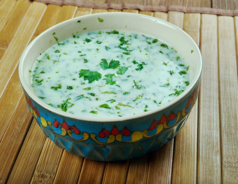 Yogurt soup. Ash-e doogh - yogurt soup from the Azeri-region of Northwest Iran stock image
