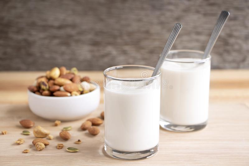 Yogurt in two glasses with dried fruit is a healthy breakfast. royalty free stock photography