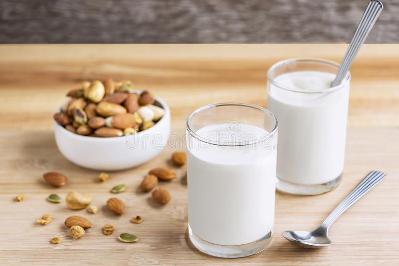 Yogurt in two glasses with dried fruit is a healthy breakfast. royalty free stock image