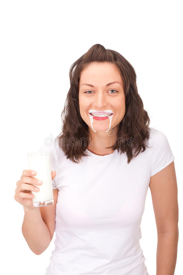 Yogurt vampire. Young lady was taking too much yogurt and now she looks like vampire. Lots of place for copy-space and your text royalty free stock photo