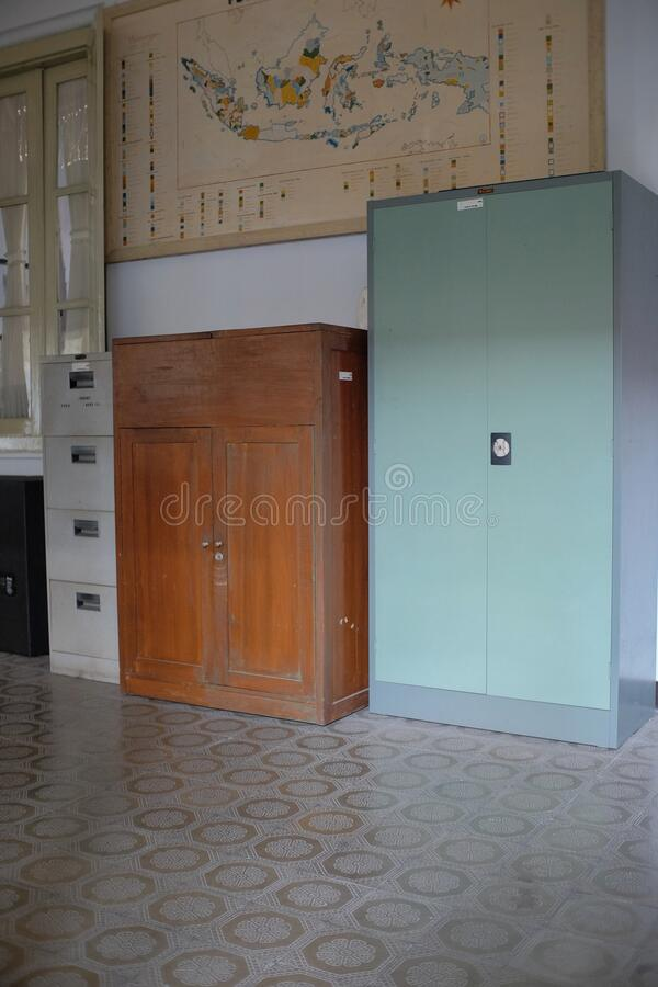 Locker cabinets for document storage in an office room. Yogyakarta, Indonesia, 12 August 2019. Two wooden and copper locker cabinets for document storage in an royalty free stock images