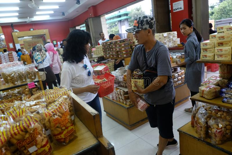 Domestic tourists are shopping at the center of food items such as bakpia. Yogyakarta-Indonesia, 13/04/2019: Domestic tourists are shopping at the center of food royalty free stock photography