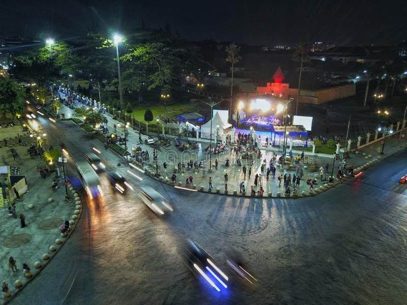 Yogyakarta, Indonesia - 27/09/2019 : People passing Yogyakarta`s Central Post Office Yogyakarta Indonesia,The New Spot in Maliobor. O Pedestrian at zero point in royalty free stock images