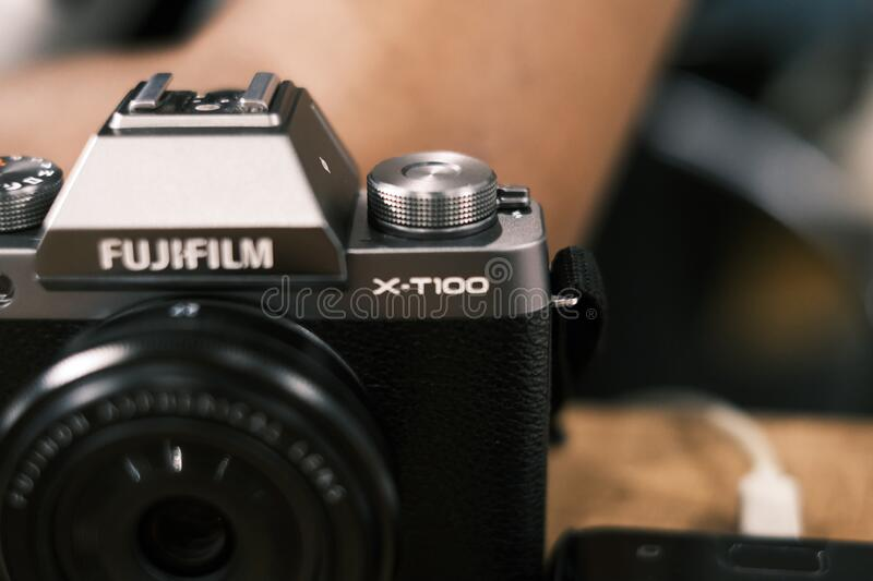 Yogyakarta, 7th march 2020. fujifilm xt100 in hand. A picture of fujifilm camera, fujifilm xt100 which held by a man in black and white photography royalty free stock photos