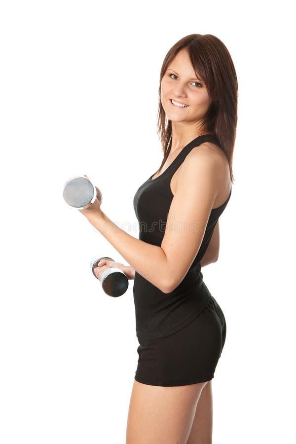 Yoing women doing weight training stock images