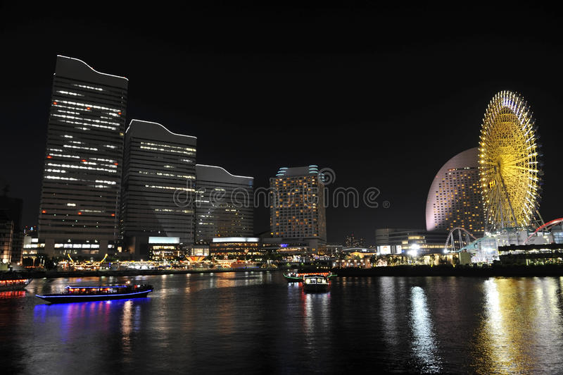 Yokohama. Night photo of Yokohama downtown reflcting in the river. Japan royalty free stock image