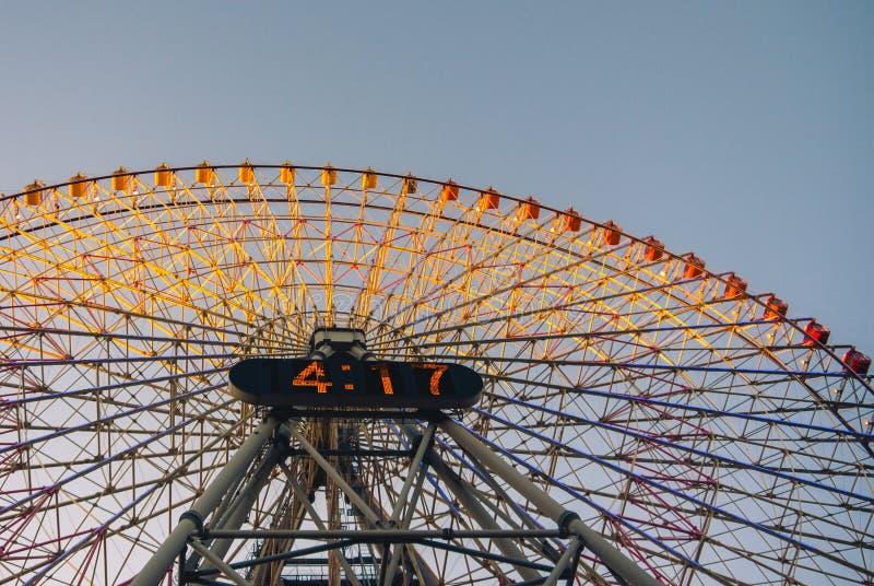Yokohama ferris wheel. Yokohama, Japan - December 22, 2014: Looking up at the giant ferris wheel `Cosmo Clock 21`, part of the Cosmo World amusement park in the stock photo