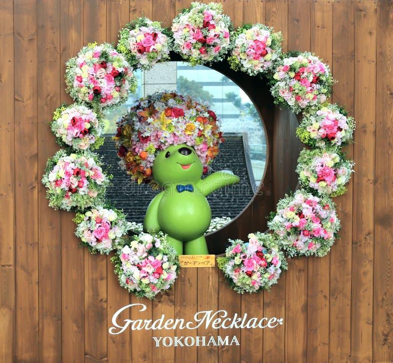 YOKOHAMA, JAPÃO - 5 de abril de 2019: Mascote do Urso do Jardim do Colar de Jardim imagens de stock royalty free