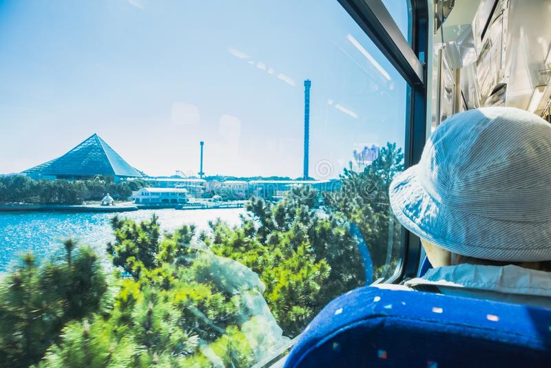 YOKOHAMA,JAPAN MAR 13, 2019 Elder people in the train staring at Yokohama Hakkeijima Sea Paradise stock image