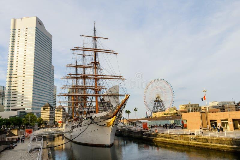 Yokohama, Japan - May 6, 2017: ship museum of Nippon Maru Memorial Park near ferris wheel of amusement park in Minato Mirai royalty free stock photography