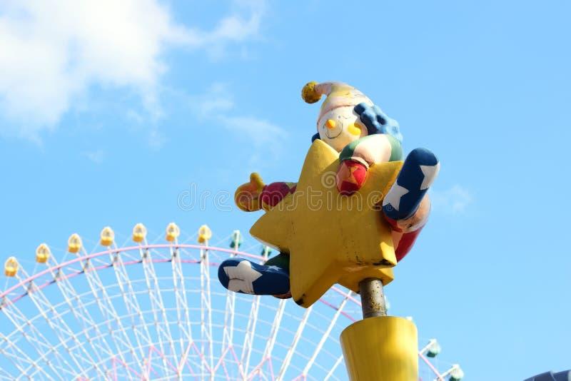 Yokohama, Japan Minato Mirai 21 Recreation facilities. Clown statue and Ferris wheel stock image