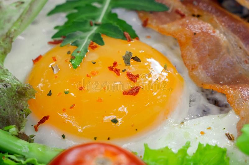 The yolk of a fried Breakfast with bacon royalty free stock photo
