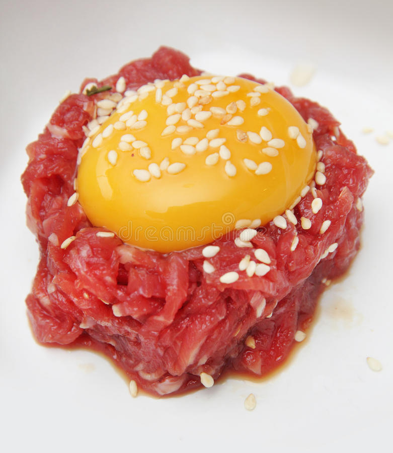Yolk on minced beef royalty free stock photo