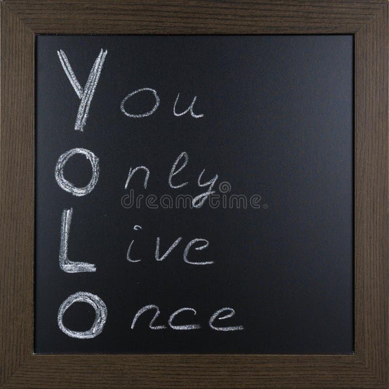 YOLO escrito à mão em um quadro-negro foto de stock