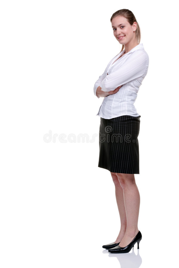 Yong businesswoman in blouse and skirt. Young blonde businesswoman wearing a pinstriped skirt and white blouse, arms folded. Isolated on white background royalty free stock photo