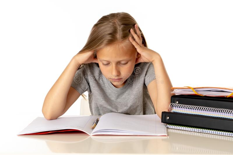 Yong cute girl tired and sad with learn problem in education concept stock image