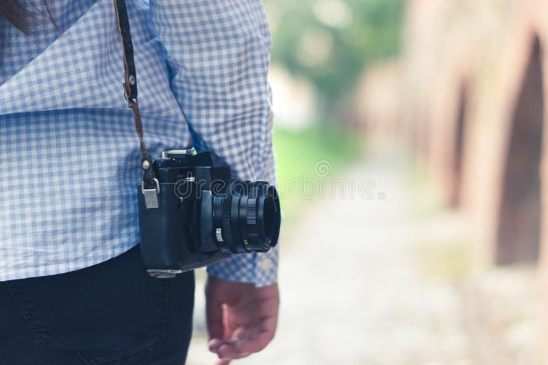 A yong girl with a vintagea camera stock images