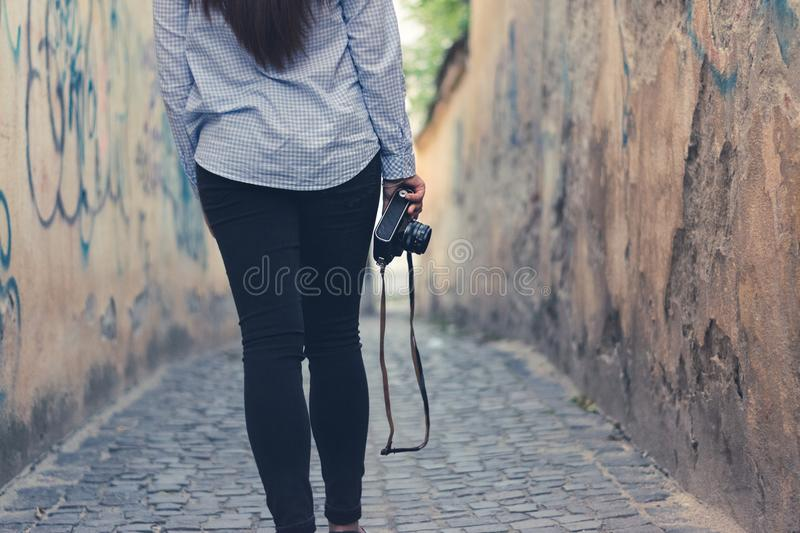 A yong girl with a vintagea camera royalty free stock image