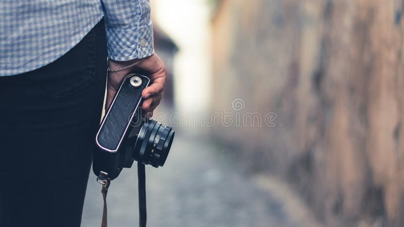 A yong girl with a vintagea camera stock image