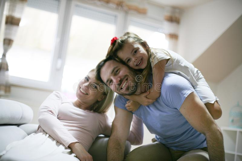 Yong happy family playing at home. stock photos