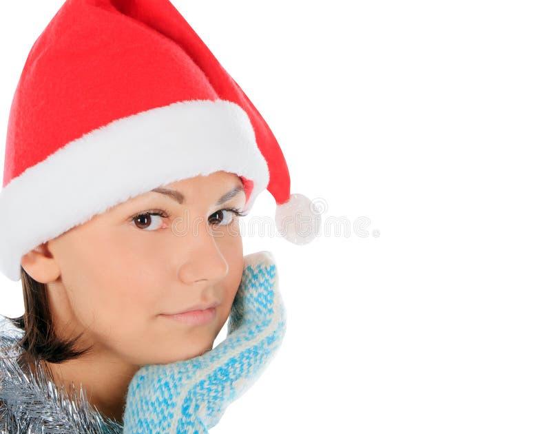 Yong kvinnlig i den santa hatten över vit royaltyfri foto