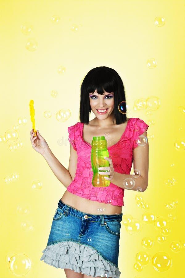 Yong woman blow bubbles