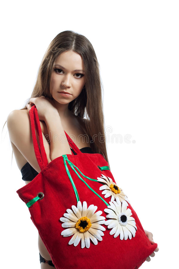 Yong woman portrait with red beach bag isolated royalty free stock image