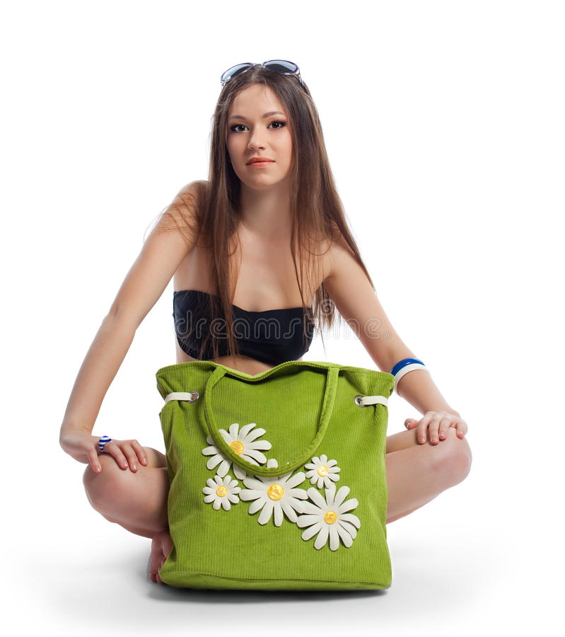 Yong woman posing with green beach bag isolated royalty free stock photo