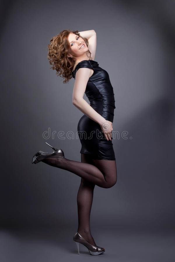 Yong woman stand in fashion leather cloth royalty free stock photography