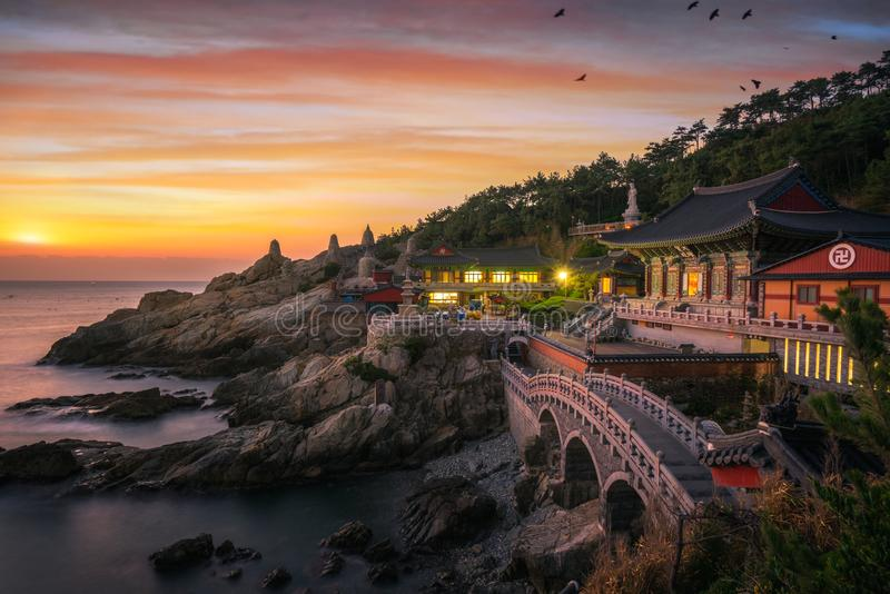 Yonggungsa temple on the beach. And rock Mountain of Busan sea, Busan city, South Korea and Korean text is the name of temple stock photography