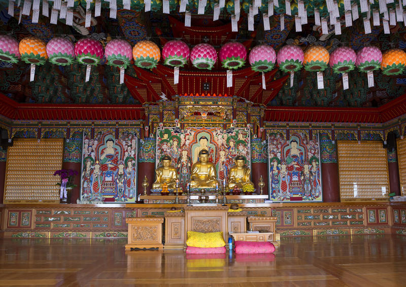 Yonggungsa Temple, Busan, South Korea. Interior. Yonggungsa Buddhist Temple located on the cliff of stone of unusual shape over the coast royalty free stock images
