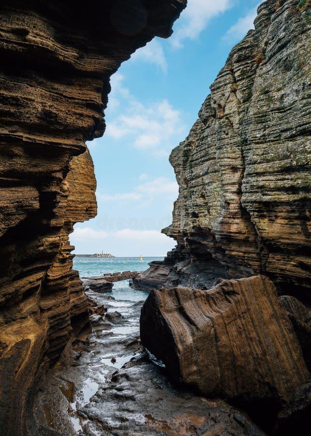 Yongmeori Beach sandstone cliff rock formation in Jeju Island, Korea. Asia stock photos