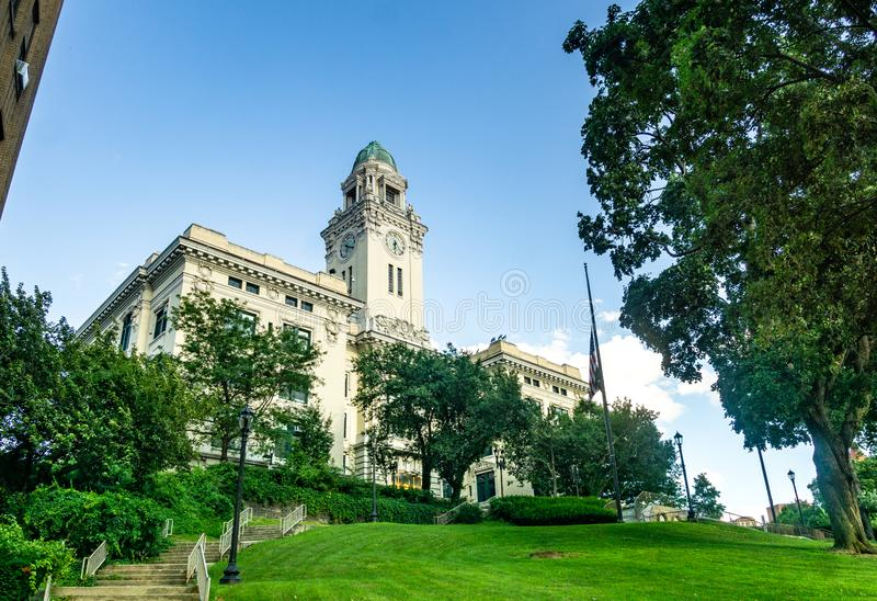Yonkers, NY / United States - Aug. 10, 2019: A view of  Yonkers historic City Hall. Three quarter view of Yonkers`s City Hall, located in downtown Yonkers stock photo
