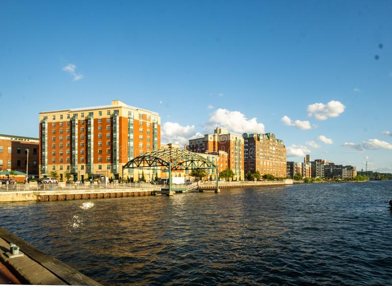 Yonkers, NY / United States - Aug. 10, 2019: A view of Yonker`s waterfront. A three quarter landscape view of Yonkers water front, showing condominiums royalty free stock photos