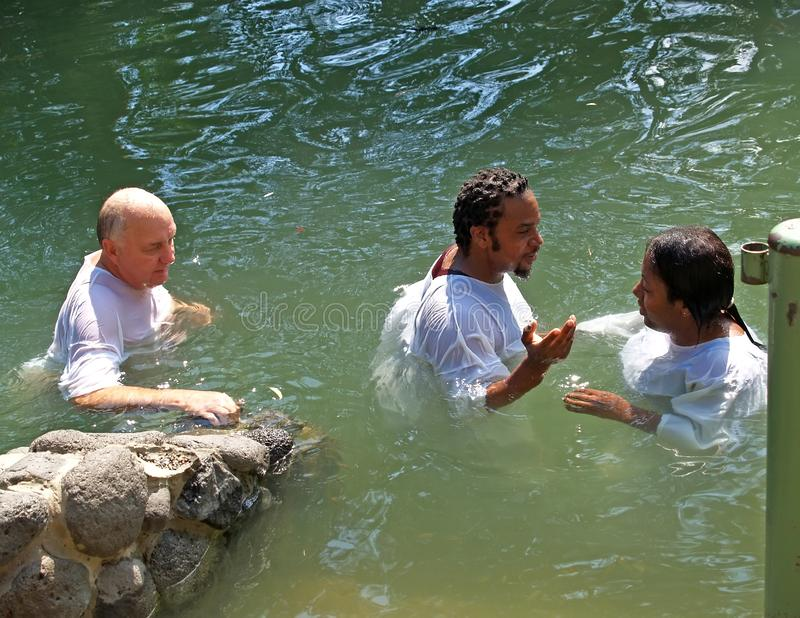 YORDANIT, ISRAEL. Pilgrims make ablution in holy waters of the Jordan River royalty free stock image