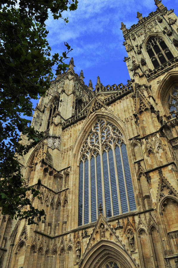 York Cathedral, Blue Sky, England, Gothic. Ancient York Cathedral Tower, Cloudy Blue Sky, sandstone and windows in England stock images