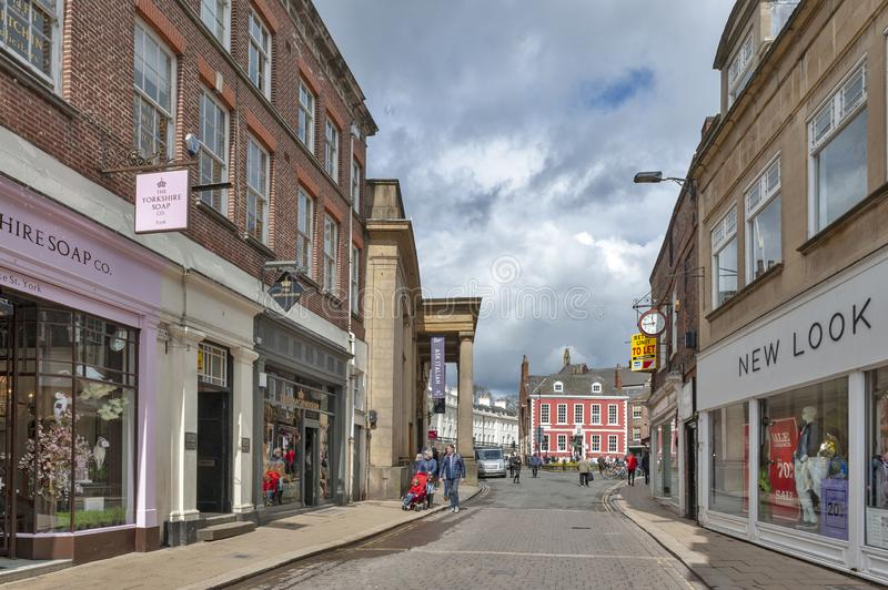 Shopping area along Blake Street towards St Leonard Place in historic district of City of York, England, UK. York, England - April 2018: Shopping area along royalty free stock image