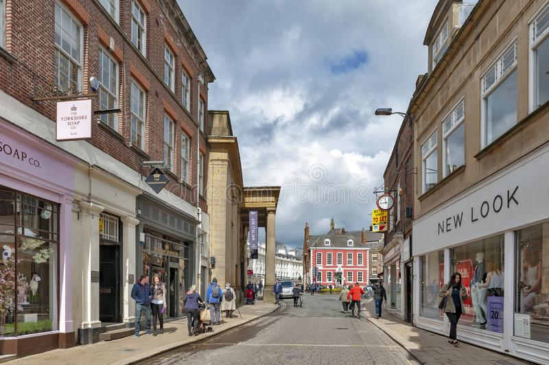 Shopping area along Blake Street towards St Leonard Place in historic district of City of York, England, UK. York, England - April 2018: Shopping area along royalty free stock photos