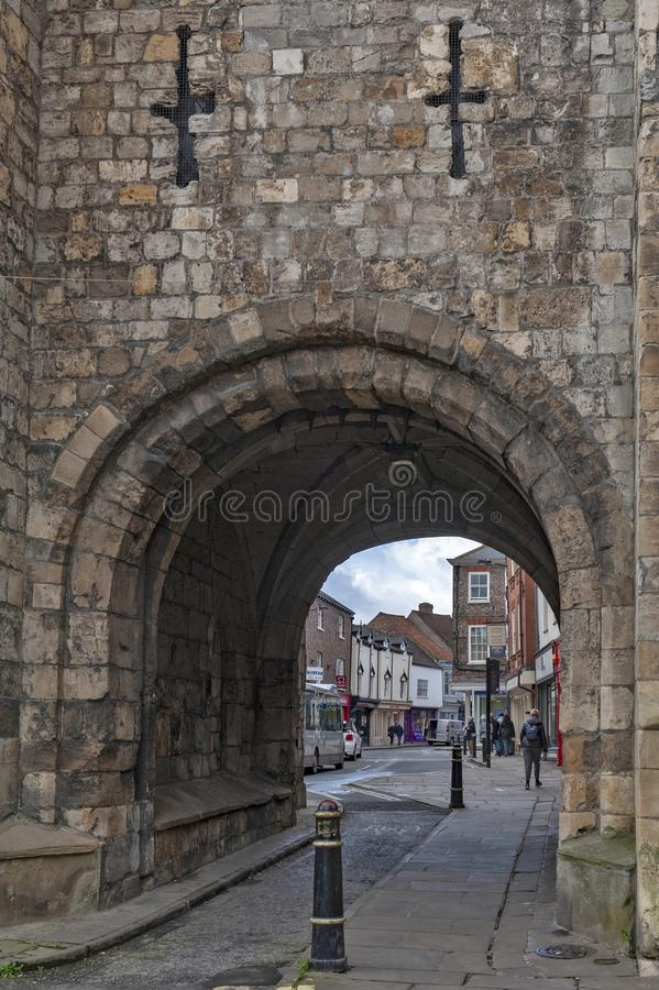 Thoroughfare under Monk Bar, main gatehouses or bars of York City Walls, leading to old city of York, England, UK stock photo