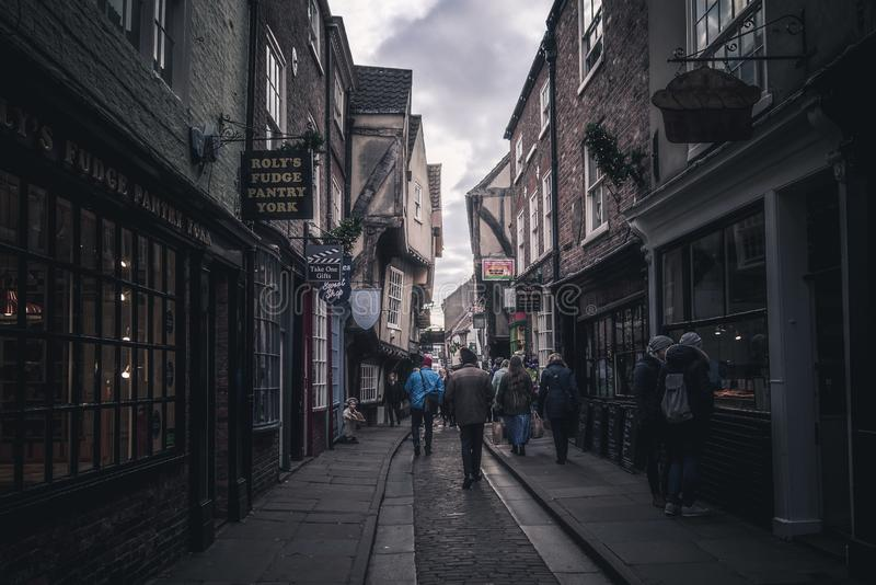 YORK, ENGLAND, DECEMBER 12, 2018: people walking in the famous The Shambles street. royalty free stock photos
