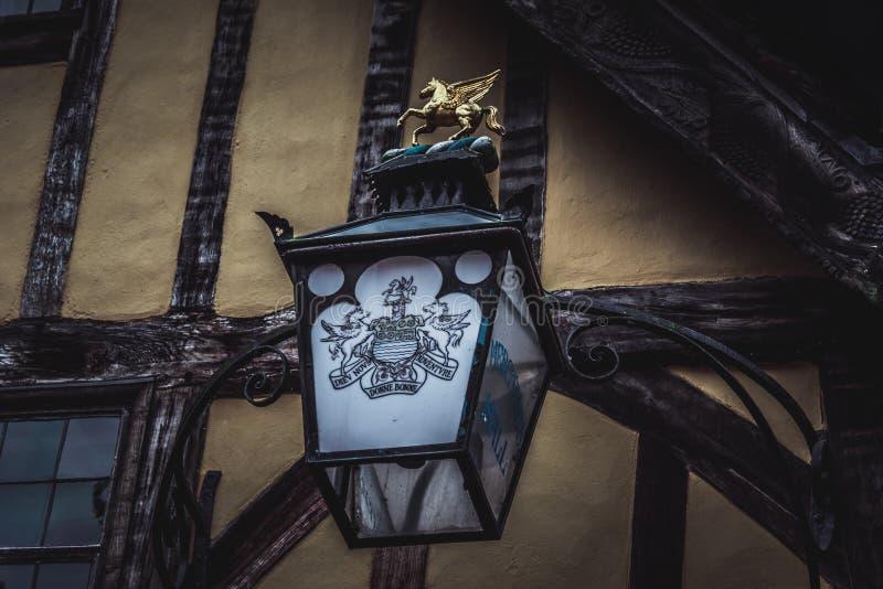YORK, ENGLAND, DECEMBER 12, 2018: Yorkshire`s Merchant Adventurers Hall doorstep old lantern with its logo and slogan.  stock image